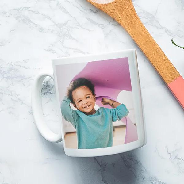 Een koffietas met een zelfgekozen foto